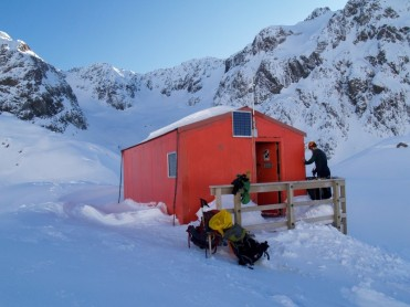 Arriving at Barkers Hut and cracking through to water supply